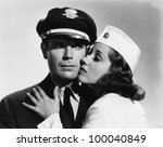 Pilot and stewardess having romantic moment - stock photo