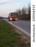 driving truck in the evening with motion blur - stock photo