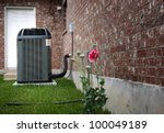 High efficiency modern AC-heater unit, energy save solution on backyard - stock photo