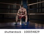 boxer pulls the bandage on the... | Shutterstock . vector #100054829