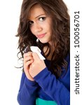 sad young woman with tissue, white background - stock photo