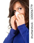 sad woman with snotty, runny nose and handkerchief, white background - stock photo