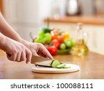 male hands cutting of cucumber...   Shutterstock . vector #100088111