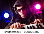 dj mixing music at disco | Shutterstock . vector #100098287