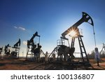 working oil pumps silhouette... | Shutterstock . vector #100136807