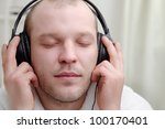 young men  listen music in headphones - stock photo