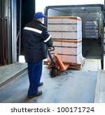 Worker Loading Truck On Forklift