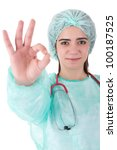 Young doctor signaling ok - stock photo