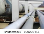 long steel pipe in oil refinery | Shutterstock . vector #100208411