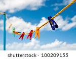 Colorful Clothes Pegs On A...