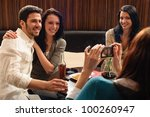 young friends at the bar woman... | Shutterstock . vector #100260947