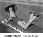 woman sunbathing at pool | Shutterstock . vector #100316051