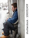 homeless young man begging in