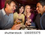 group of friends enjoying sushi ... | Shutterstock . vector #100355375