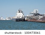 A Great Lakes self discharging bulk carrier ship prepares to take on a load of taconite from the Cleveland Bulk Terminal located in the west basin of the Cleveland, Ohio harbor. - stock photo