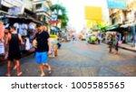 blurred people walking on khao... | Shutterstock . vector #1005585565