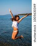 Small photo of The girl enjoys the sea. Aegean Sea, Greece