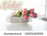 stacked plates with floral... | Shutterstock . vector #1005630904