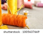 spool of sewing thread with... | Shutterstock . vector #1005637669