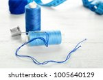 spools of sewing threads on... | Shutterstock . vector #1005640129