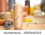 spool of sewing thread with... | Shutterstock . vector #1005640165