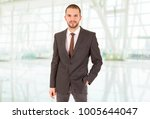 happy business man portrait at... | Shutterstock . vector #1005644047
