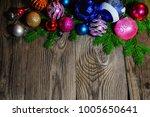christmas balls lie on fir... | Shutterstock . vector #1005650641