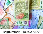 close up of 500 argentine pesos ... | Shutterstock . vector #1005654379