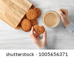 woman with oatmeal cookies and... | Shutterstock . vector #1005656371