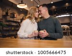 a couple is sitting in the cafe ... | Shutterstock . vector #1005666475