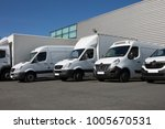 white delivery trucks backed up ... | Shutterstock . vector #1005670531