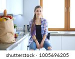 portrait of young woman... | Shutterstock . vector #1005696205