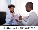 two young happy men sitting on... | Shutterstock . vector #1005700267