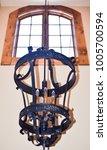 rustic chandelier hanging in... | Shutterstock . vector #1005700594