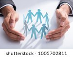 close up of a businessperson's... | Shutterstock . vector #1005702811