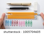 person's finger arranging the... | Shutterstock . vector #1005704605