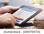 close up of a businessperson's... | Shutterstock . vector #1005704731
