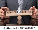 close up of a businessperson's... | Shutterstock . vector #1005704827