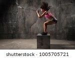 fit young woman box jumping at... | Shutterstock . vector #1005705721