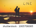 silhouette of a couple in love... | Shutterstock . vector #1005708385