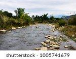 streams in the distant hills.... | Shutterstock . vector #1005741679