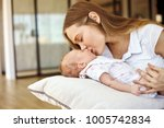youngg caucasian mom with... | Shutterstock . vector #1005742834