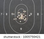 Small photo of Closeup of pistol target, for handgun Service discipline, showing good shooting accuracy in a competition