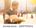male students  looking at a...   Shutterstock . vector #1005759241
