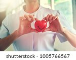 happy red smiling face heart in ... | Shutterstock . vector #1005766567