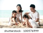 happy asian family playing on... | Shutterstock . vector #100576999