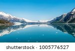 reflection of mountains in calm ... | Shutterstock . vector #1005776527