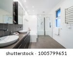 large modern bathroom interior... | Shutterstock . vector #1005799651