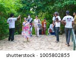 Small photo of DAMBULLA, SRI LANKA - NOV 2016: Obtrusive souvenir dealers propose their goods to tourists on a way to Golden cave temple.