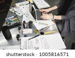 the artist's hand behind the...   Shutterstock . vector #1005816571